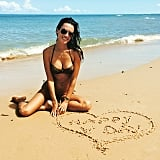 Alessandra Ambrosio drew a heart in the sand during a day at the beach.
