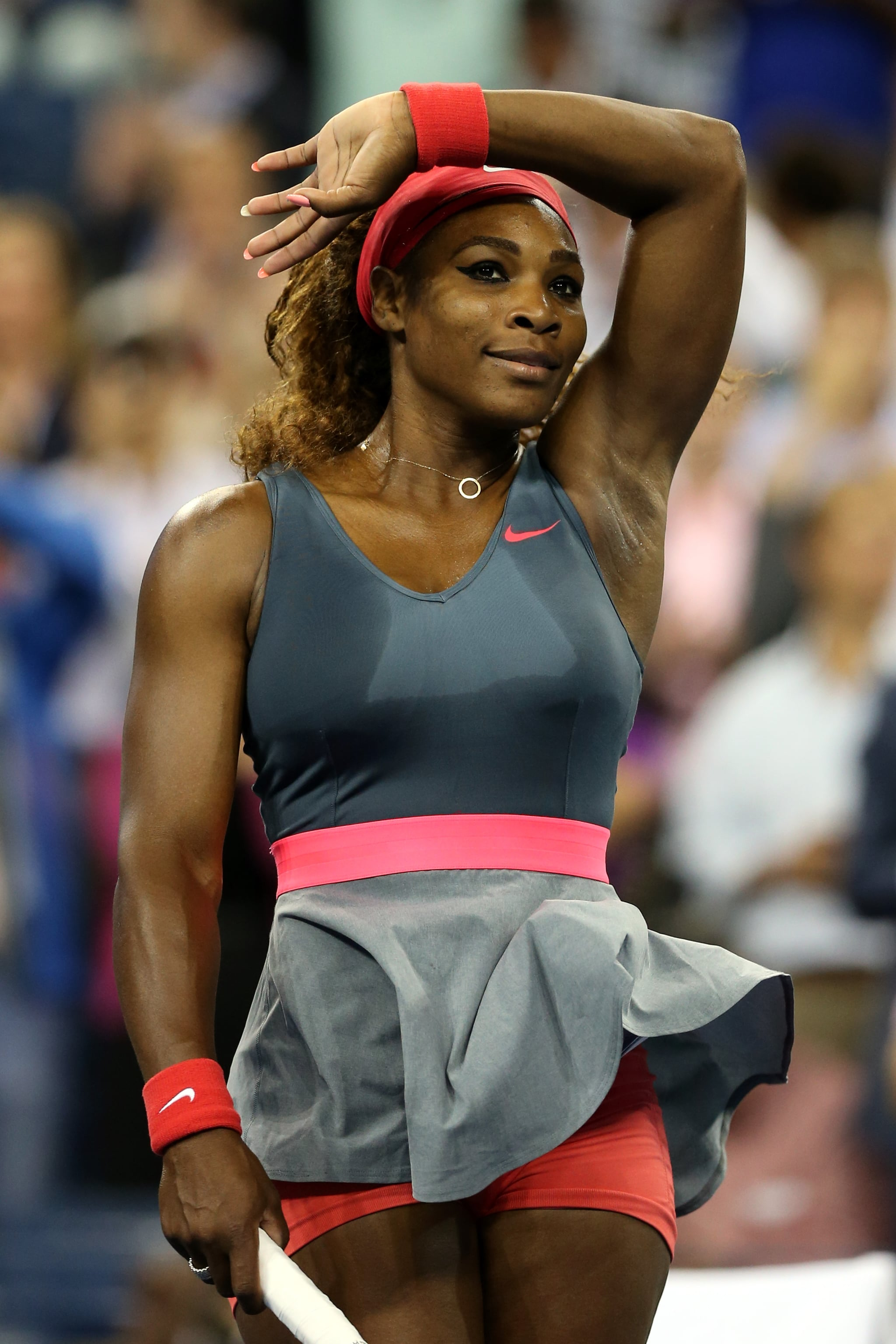 Serena Williams paired dark gray with pops of pink and red at the 2013 US Open.