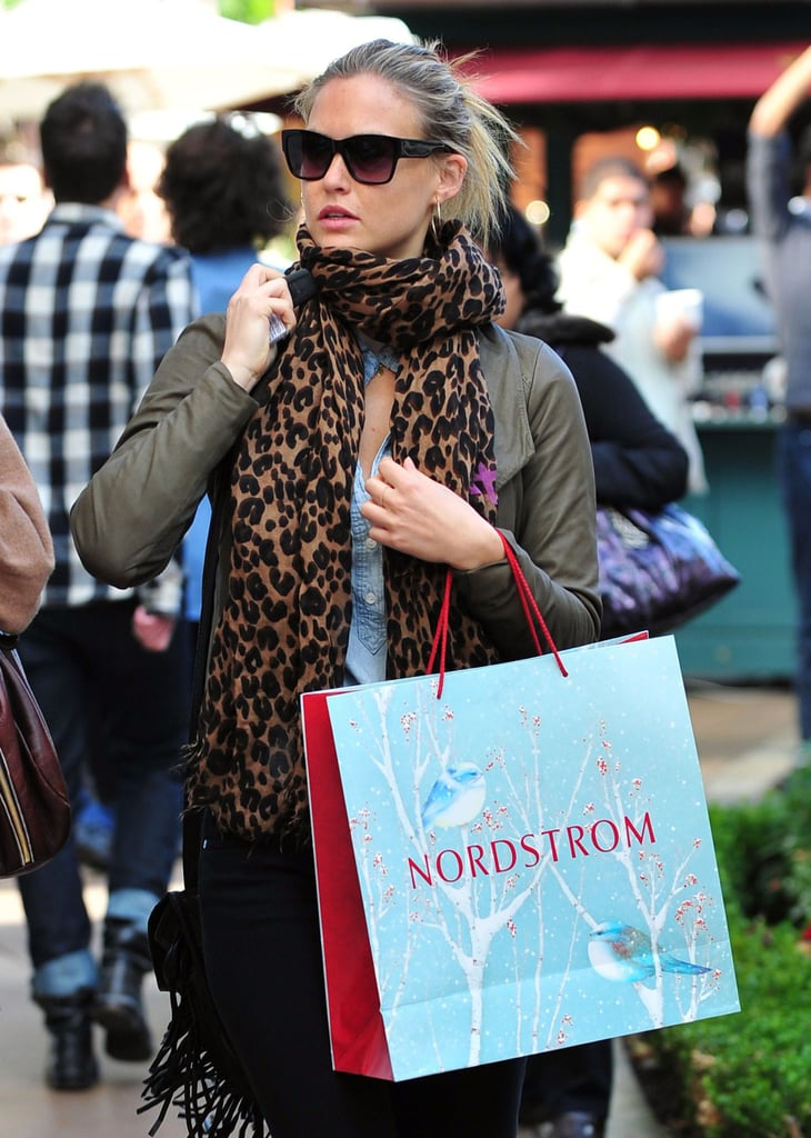 Bar Refaeli layered up in a scarf for a shopping trip yesterday at The Grove in LA. Hanukkah and all its presents has already come and gone, but Bar still has Christmas to celebrate with her man Leonardo DiCaprio. If you're looking for last minute ideas for anyone on your list, don't miss our hundreds of gift guides! Bar is once again among our hottest bikini moments of the year and the 2009 two-piece champion is also one of the sexiest female stars. Leonardo is always a favorite as well and perhaps the lovebirds will jet off on another exotic vacation to celebrate the holidays or ring in 2011.