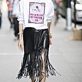 With a Fringed Skirt and Graphic Sweatshirt