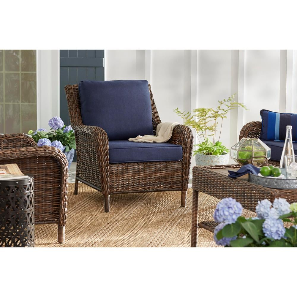 Wicker Outdoor Lounge Chair With Blue Cushions
