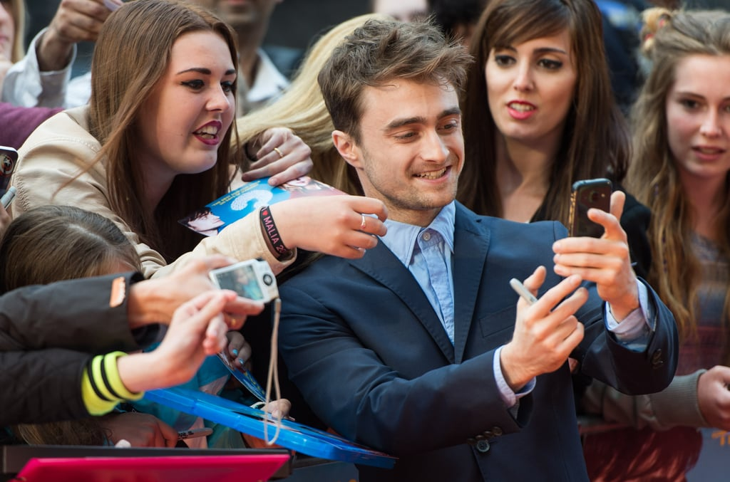 Daniel Radcliffe got cute with his fans at the Tuesday-night premiere of What If in London.
