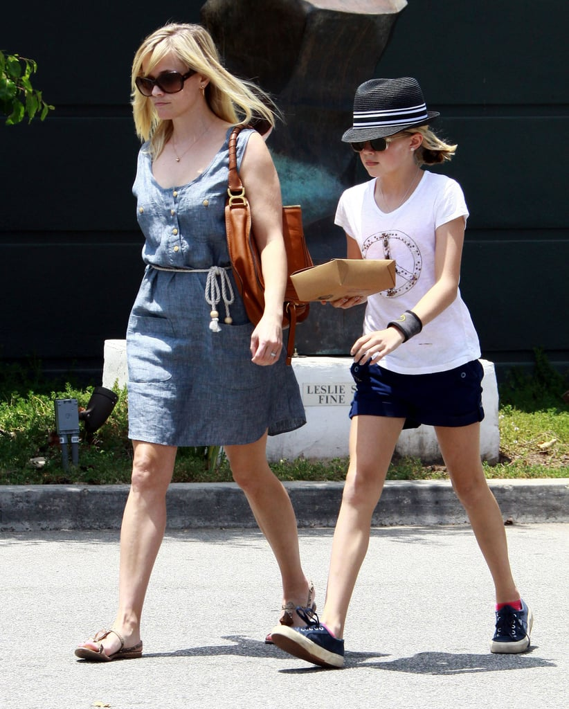 Reese Witherspoon and daughter Ava Phillippe carried their leftovers out after lunch in LA yesterday. Reese also did a quick change and made a solo shopping stop at Brentwood Country Mart the same day, wearing a pop of pink on her necklace and toting a matching canvas bag by American Eagle Outfitters. Reese, Ava, and Deacon Phillippe are back home in LA after joining Jim Toth for a recent trip to Nashville to visit family over the weekend. On Monday, Reese shot a new ad for Stand Up 2 Cancer, a charity she's been involved in for several years. Reese hasn't been on the set of a movie since wrapping Water For Elephants at the beginning of the year, but she is already attached to several future projects, including Who Invited Her. The comedy will feature Reese as a bachelor-party crasher, and she's also planning to take on a role behind the scenes, serving as the film's producer as well.