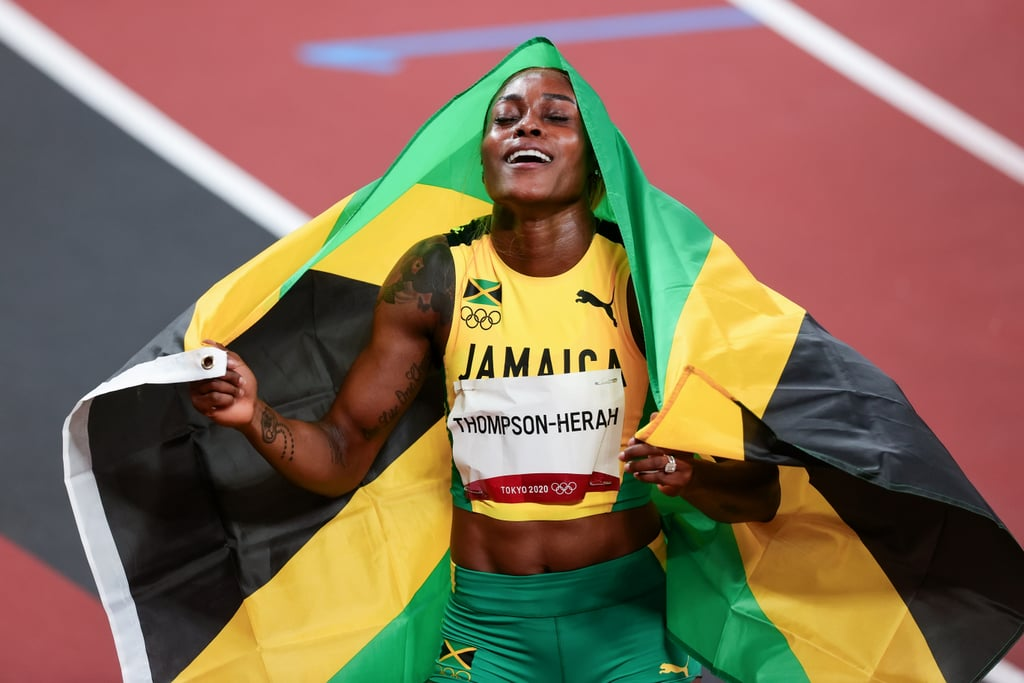 """Elaine Thompson-Herah's legacy as the fastest woman in the world continues. On July 31, the Jamaican athlete earned her third gold medal and broke Florence Griffith Joyner's (Flo-Jo) 33-year-old Olympic record in the women's 100-meter race. Thompson-Herah is 29 years old herself, thus beating a record older than she's been alive. With a finishing time of 10.61 seconds, Thompson-Herah made history.  Joyner's 1988 record of 10.61 seconds was set in Seoul. Her 100-meter world record of 10.49 seconds still stands. Thompson-Herah believes she can sprint past that time as well, telling reporters """"anything is possible"""" after her race. The track star's win is even more impressive given an Achilles injury that she thought would keep her out of the Tokyo Games less than two months ago. However, her persistence drove her past the finish line, and she plans to keep pushing herself. """"I have more years. I'm just 29; I'm not 30, I'm not 40. I'm still working,"""" she said, according to CNN. See photos of Thompson-Herah's well-deserved celebratory reaction to her gold medal moment, ahead.       Related:                                                                                                           Win or Lose, Olympic-Bound Runner Kendall Ellis Will Always """"Be a Dog in the Race"""""""