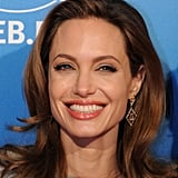 Angelina Jolie flashed a smile at the Cinema for Peace awards.