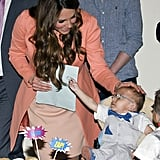 Kate shared a precious moment with a little boy while visiting England's Naomi House Children's Hospice in April 2016.