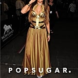 Selena Gomez worked her stuff in a gold outfit.