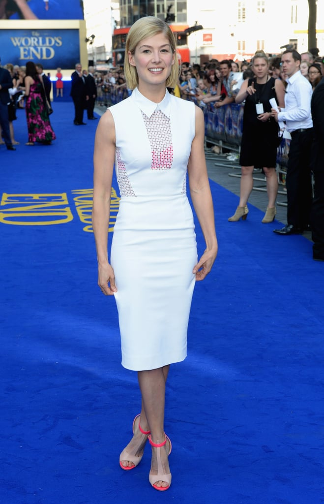 Rosamund Pike set off her Victoria Beckham sheath with neon heels on the blue carpet for London's The World's End premiere.