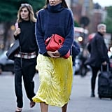 Contrast Fabrics When You Throw a Wool Sweater Over Your Silk Slip and Wear Satin Booties
