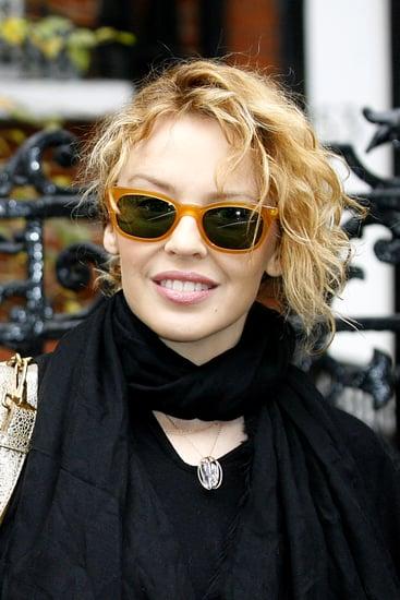 Kylie Minogue wearing mustard sunglasses in London