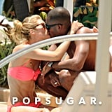 Supermodel Doutzen Kroes shared a kiss with husband Sunnery James during a June layover in Miami.