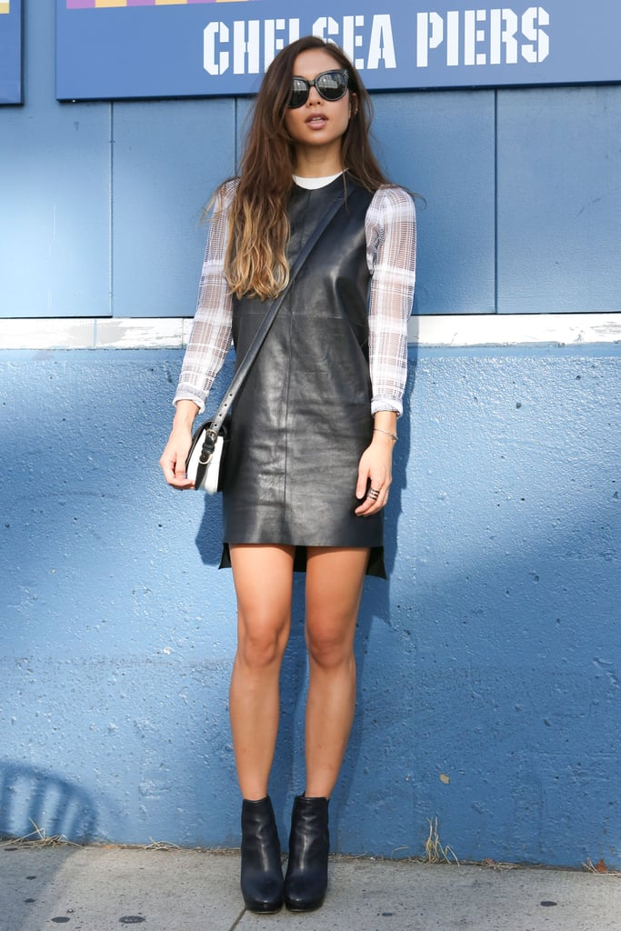 Take note of this styling trick and add a tee or long-sleeved top underneath a leather dress to make it work for day.