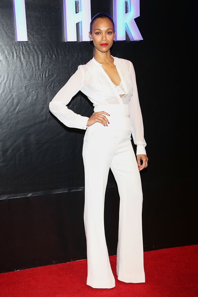 Zoe Saldana stunned in a white long-sleeved Elie Saab jumpsuit at the Mexico City premiere of Star Trek Into Darkness. The sheer chiffon bodice and cummerbund detail are too sexy for words.