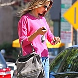 Alessandra Ambrosio checked the time.