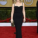 Amy Poehler embraced a sexy silhouette in this curve-hugging Zuhair Murad gown with figure-flaunting darting and a sweetheart neckline.