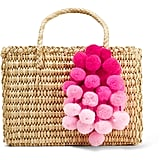Keep the pom-pom trend alive with the Nannacay Maldives Baby Pompom Woven Tote ($152).