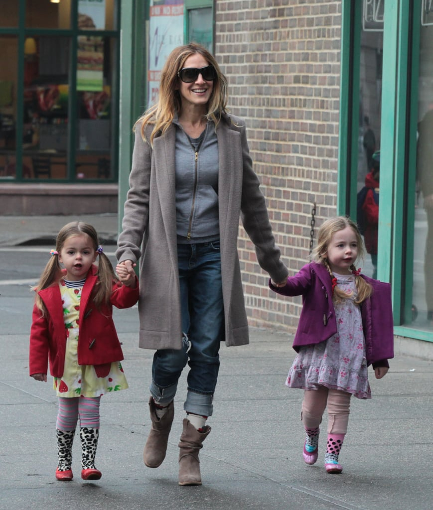 Sarah Jessica Parker held on tight as she walked her two three-year-old daughters, Marion and Tabitha, through New York on January 29.