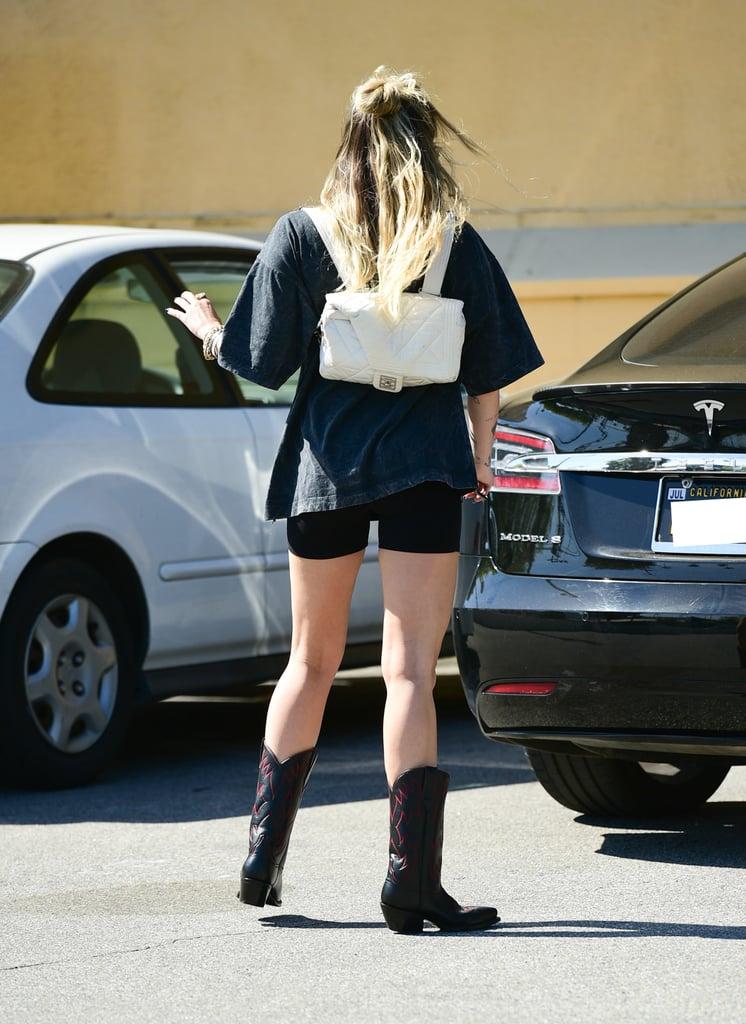 Miley Cyrus Wearing Biker Shorts and Cowboy Boots