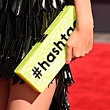 We went crazy over Victoria Justice's totally fun, neon Edie Parker #hashtag clutch.