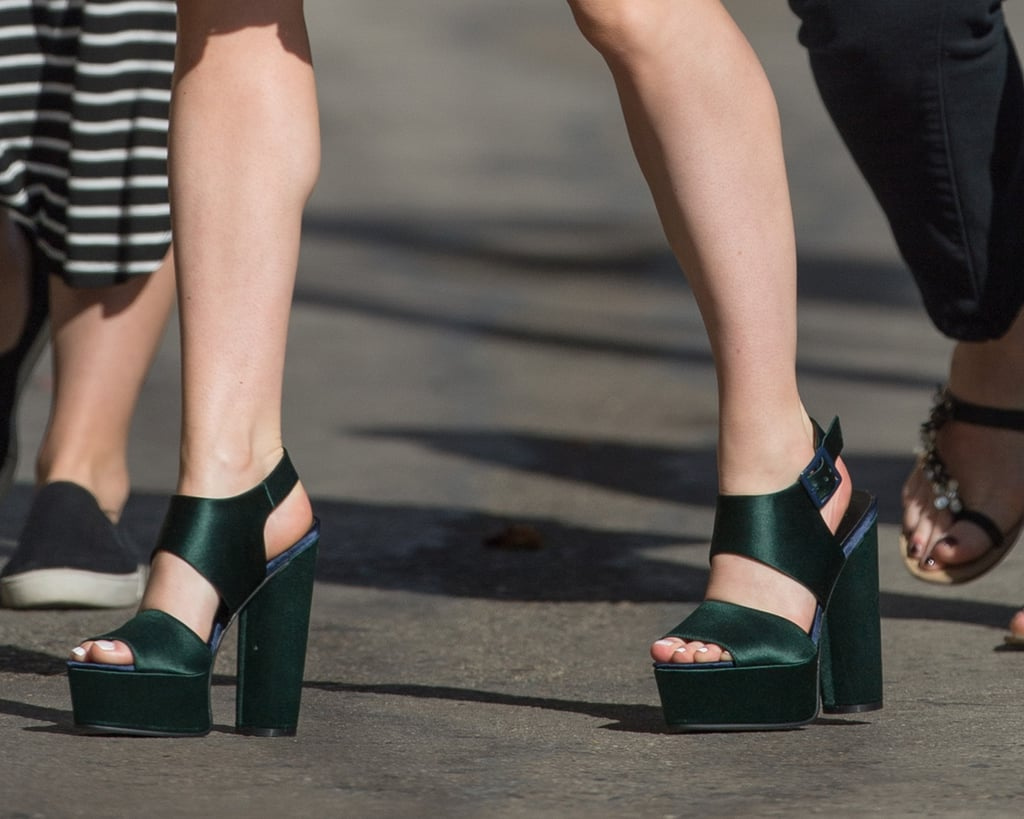 As for shoes, Maisie gave herself a boost with a pair of dark green platforms.