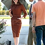 Emma Stone put her hand in her pocket.