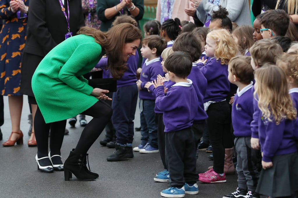"It's another day, another royal engagement for Kate Middleton. On Feb. 5, the Duchess of Cambridge visited two schools to find out how the charity Place2Be's Children's Mental Health Week is providing ""support and training for emotional well-being."" This year, the charity's theme is ""Health: Inside and Out"", so Kate took her time to meet children from Lavender Primary School to find out how the work is helping them (and watch them jogging) before moving on to visit Alperton Community School. She received an adorable musical welcome from Lavender Primary School as the children sang and held up posters that explained how ""singing helps all the bad stuff go out and all the good stuff go in."" There were plenty of other cute moments, particularly when Kate was asked to show the children an object that makes her feel happy, and she presented a photo of her family. Kate has a long history with the charity Place2Be. She was involved with the organisation before she became an official member of the royal family, and it's a charity she is strongly passionate about. Ahead, get a closer look at her latest visit in support of the charity."