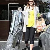 Olivia Wilde had her hands full during a Monday errand run in West Hollywood.