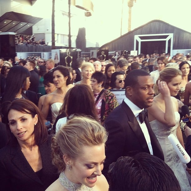 Amanda Seyfried, Chris Tucker, and Jennifer Lawrence worked the press line at the Oscars. Source: Instagram user marcmalkin