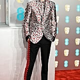 Timothée's look at the 2019 EE British Academy Film Awards consisted of a printed Haider Ackermann suit with checkerboard-striped trousers.
