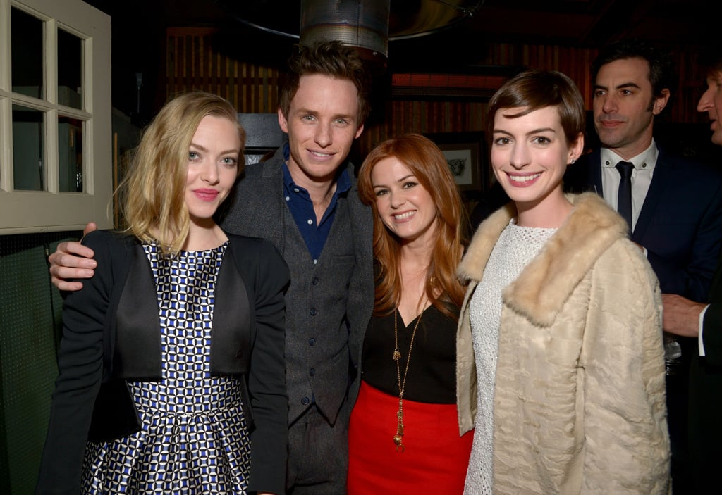 Anne Hathaway shared laughs and drinks with her Les Misérables costars at a special pre-Oscars bash in LA last night. She donned a Theyskens' Theory minidress as she celebrated with a Dior-wearing Amanda Seyfried, Eddie Redmayne, and Isla Fisher, who attended the shindig with her husband, Sacha Baron Cohen. The Les Misérables fete supported the Los Angeles Fund For Public Education, and drew other celebrities like Adrien Brody and Judy Greer. The celebration wasn't to be confused with the separate Vanity Fair party for Silver Linings Playbook, which also benefited education in LA and was held on the same night.  The pre-Oscars parties are just getting started, and the casts of both films will have plenty of chances to celebrate before Oscar night on Sunday, Feb. 24. Don't forget to fill out our Oscar ballot for a chance to win $1,000 and an iPad.