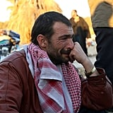 A Syrian man cries after he's evacuated from Aleppo and arrives at the military-controlled Khan al-Aassal region on Dec. 15.