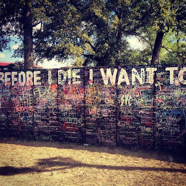 """Out of all of the amazing art projects at Bonnaroo, one of our favorites had to be the Before I Die wall, where attendees could use paint or chalk to write out their hopes and dreams. Some of the most memorable answers were """"matter"""", """"save a life"""", and """"dance with Obama"""". Source: Instagram user popsugarfashion"""