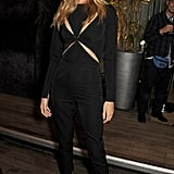 Rosie added snakeskin Louboutin pumps to her cutout Stella McCartney jumpsuit for a sexy look in 2013.