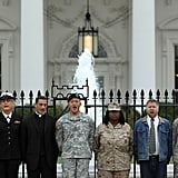 """Gay rights activists and gay veterans handcuff themselves to the White House to protest """"don't ask, don't tell"""" in November 2010."""