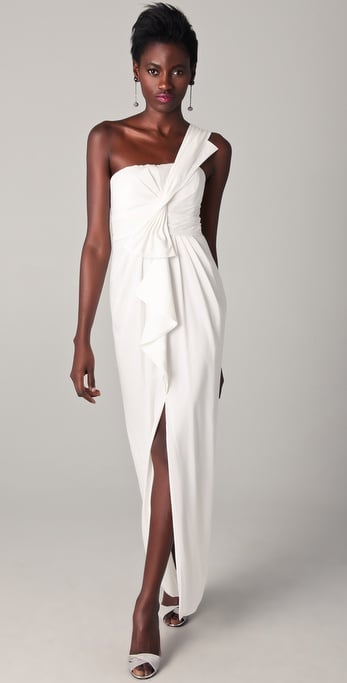 Make an entrance in a modern-cut asymmetrical gown with a slit that'll let you move and groove on the dance floor.  BCBG Max Azria Barbara One Shoulder Gown ($288)