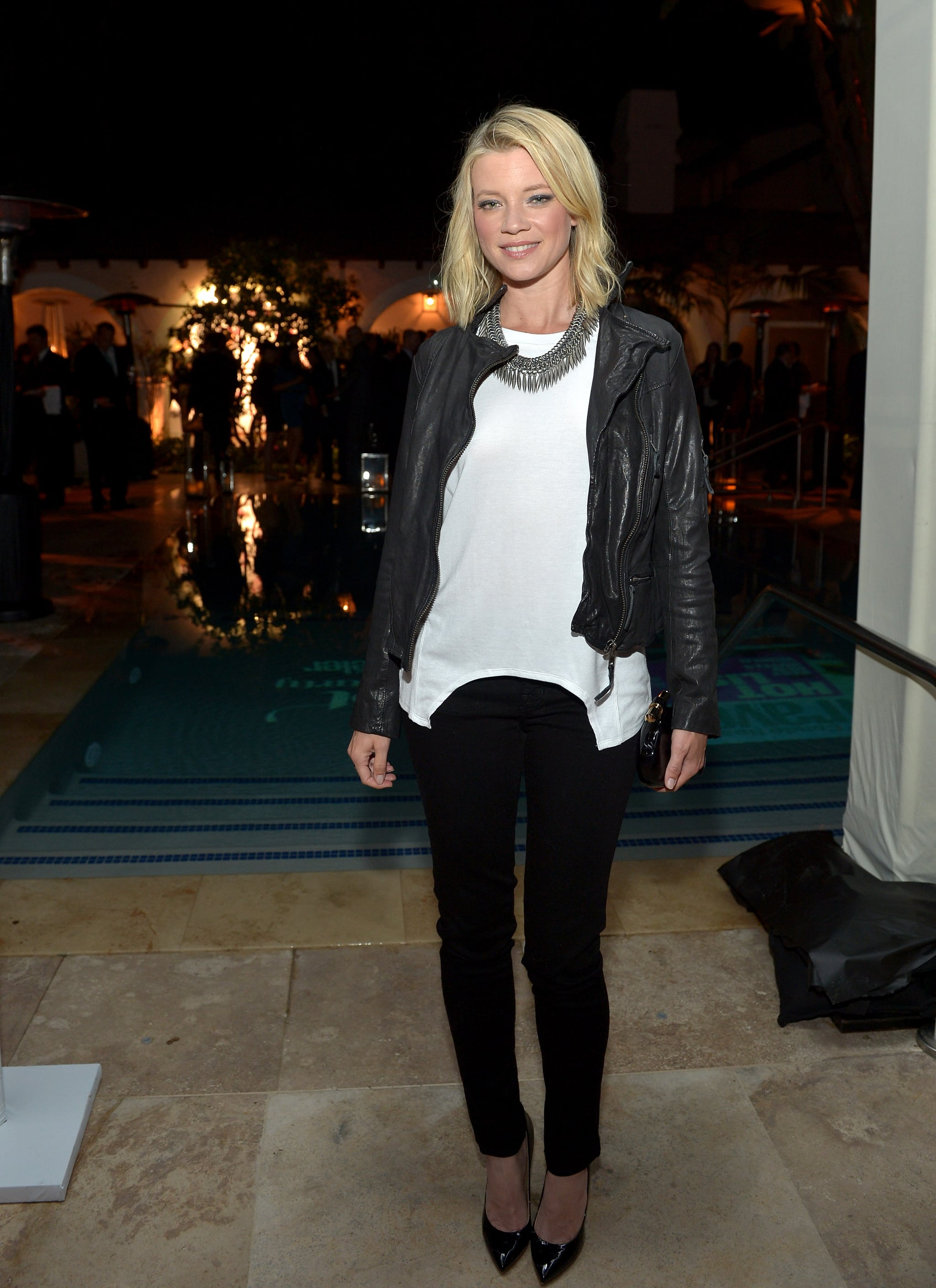 Amy Smart Hot Images amy smart wore a leather jacket with a white tee to the