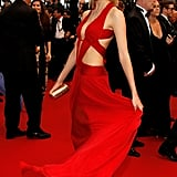 Natasha Poly channeled the sexiest kind of glam in a skin-baring red cutout gown.
