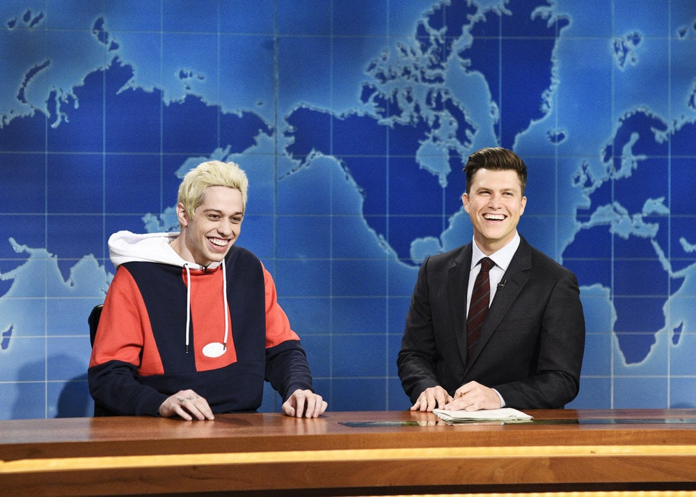 """Saturday Night Live made its return after an eventful off-season, and Pete Davidson certainly addressed his high-profile romance with Ariana Grande. During the show's Weekend Update segment, the 24-year-old comedian commented on his engagement and said, """"Do you remember when that whole city pretended that kid was Batman because he was, like, sick? That's what this feels like.""""  Pete then went on to joke about his rent-free lifestyle and made a pretty dark remark about how he's exchanged the singer's birth control pills for Tic Tacs so that they would be bonded together forever in the event of a breakup. In addition, Pete said he looks forward to receiving royalties off Ariana's song titled after him on her album Sweetener — especially once he's working at Walmart sometime in the future.      Related:                                                                                                           In This SNL Skit, Pete Davidson Isn't the Only Cast Member With a Celebrity Girlfriend"""