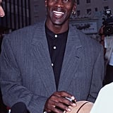 Michael wore a grey blazer with a mandarin-collar button-up shirt and his signature single earring to the premiere of Space Jam in Los Angeles in 1996.