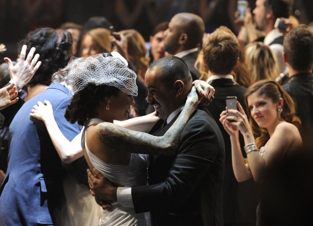 """After Macklemore & Ryan Lewis performed """"Same Love"""" at the Grammy Awards, more than 30 couples lined up in the aisles to say """"I do."""" With Queen Latifah as the officiant, the couples stood holding hands and exchanged wedding bands. Afterward, Madonna hit the stage in a white tuxedo-inspired outfit to sing """"Open Your Heart,"""" and actress Anna Kendrick snapped an up-close photo of the nuptials from her seat. The mass wedding marked a particularly special moment for Ryan Lewis, because his sister, Laura, and her fiancé were among the couples. Ryan called it """"a night that is already tremendous for me, for the music,"""" adding, """"but to have my sister get married and my family there watching it — that makes it a whole other level of amazing."""" Watch the full performance below, and then take a look at all the heartwarming photos from the Grammys nuptials! Source: Getty / Kevork Djansezian"""