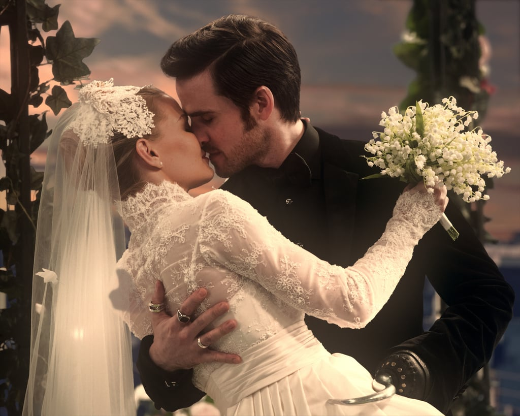 Once Upon a Time fans: we hope you're sitting down for this. We've been shipping Captain Hook and Emma Swan ever since their first encounter in season two, and now they're finally tying the knot! So far, we've only seen two stills from their wedding (which will double as the musical episode), but we also managed to grab a few GIFs from the episode's preview.  While Hook looks dapper in his fitted tux, it's the Savior who really steals the show in her Grace Kelly-inspired gown and veil. And just look at how happy the Charmings look walking her down the aisle! The fate of the show might be unclear, but we've never been more sure of Emma and Hook's love for each other. Is it possible that these two lovebirds will finally get their happy ending? Guess, we'll just have to tune in on Netflix to find out.