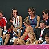 Kate Middleton laughed with fellow spectators while watching Team GB's women's field hockey.