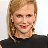 A high neckline necessitated the actress go sans necklace, but she glammed things up with large gold danglers.