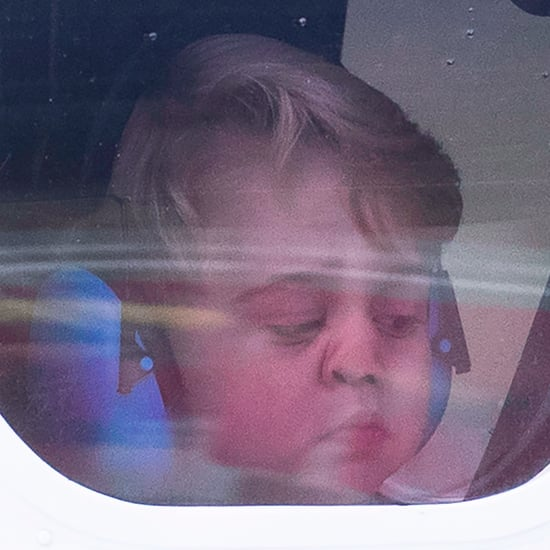Prince George's Face Against Plane Window in Canada Pictures
