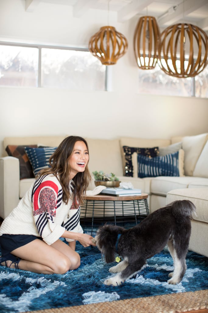 The newly revamped living room is the perfect spot for the entire family to gather and cuddle — even the pup!  Jamie's room design is by Decorist and the shoot was styled by Merisa Libbey Designs.