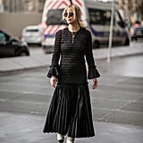 Style a pleated maxi with cap-toe boots.