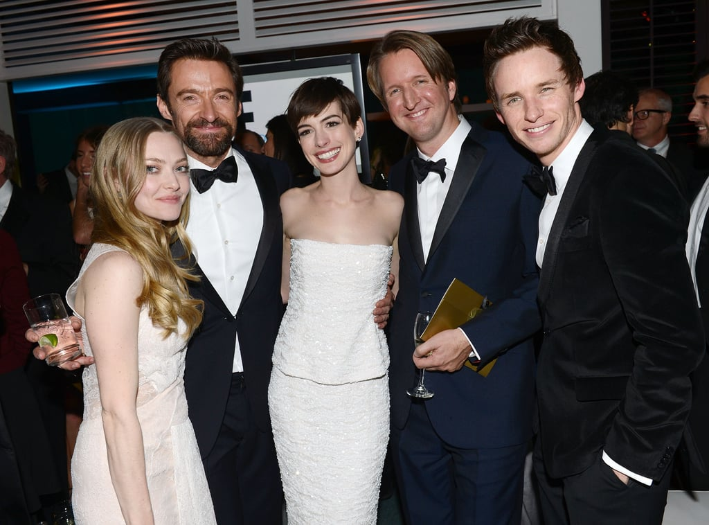 Amanda Seyfried, Hugh Jackman, Anne Hathaway and Eddie Redmayne posed with director Tom Hooper.
