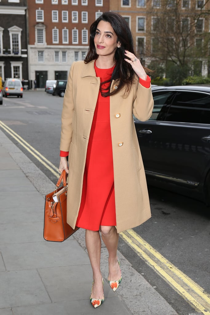 Amal mixed '60s-inspired vintage pieces, including her Balmain coat and Dior shift, with bright, pixelated Oscar de la Renta heels for an appearance at London's Chatham House.