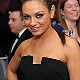 Mila opted for a sleek ponytail and smoky eye makeup for the White House Correspondents' Dinner Cocktail Party in 2011.