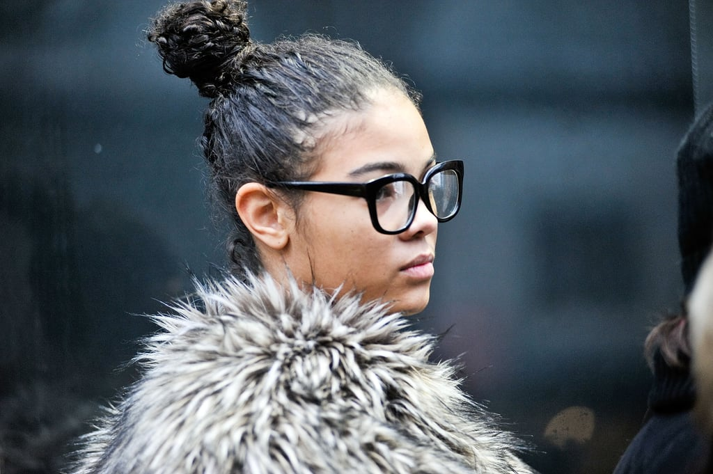 Topknots are still one of the trendiest updos around and pair gorgeously with high-texture strands.
